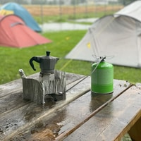 Coffee is important. Even with constant downpouring. At least the tent is still dry inside.