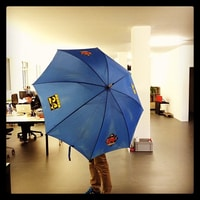 we got a radio24 / tele24 umbrella from the old caretaker of this building. cool.