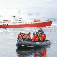 the antarctic dream with a zodiac in front